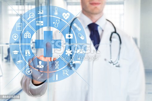 istock Medical doctor touching AR interface icons, health care services, hospital 844414316