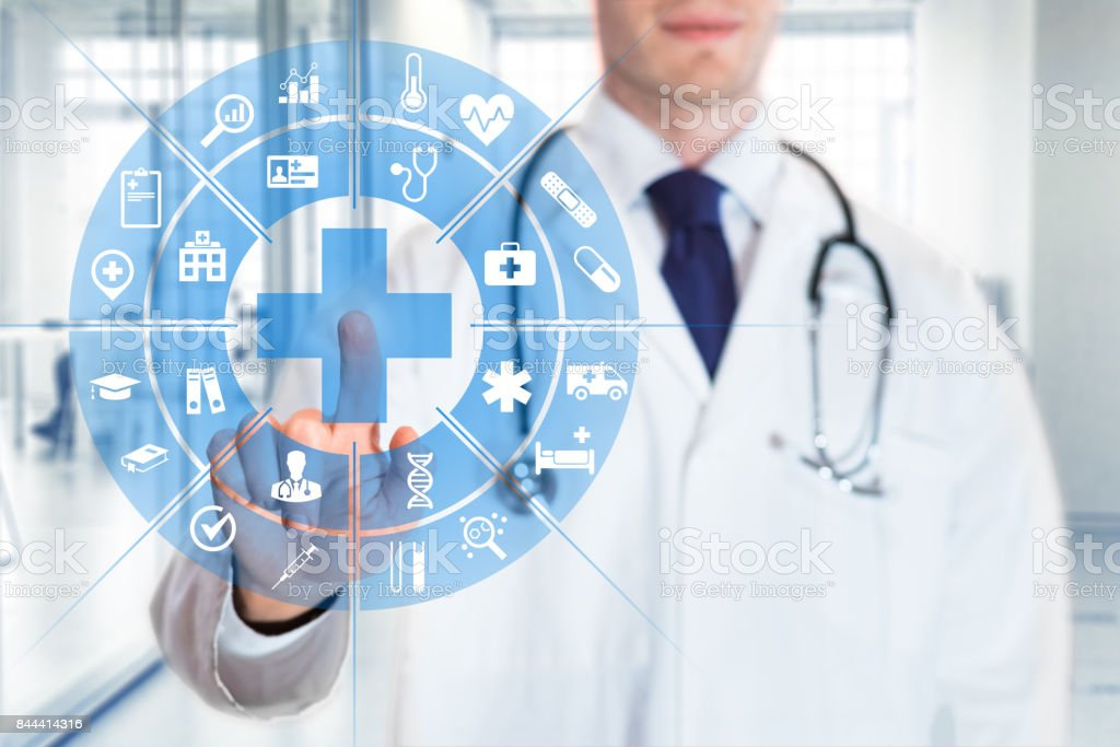 Medical doctor touching AR interface icons, health care services, hospital stock photo