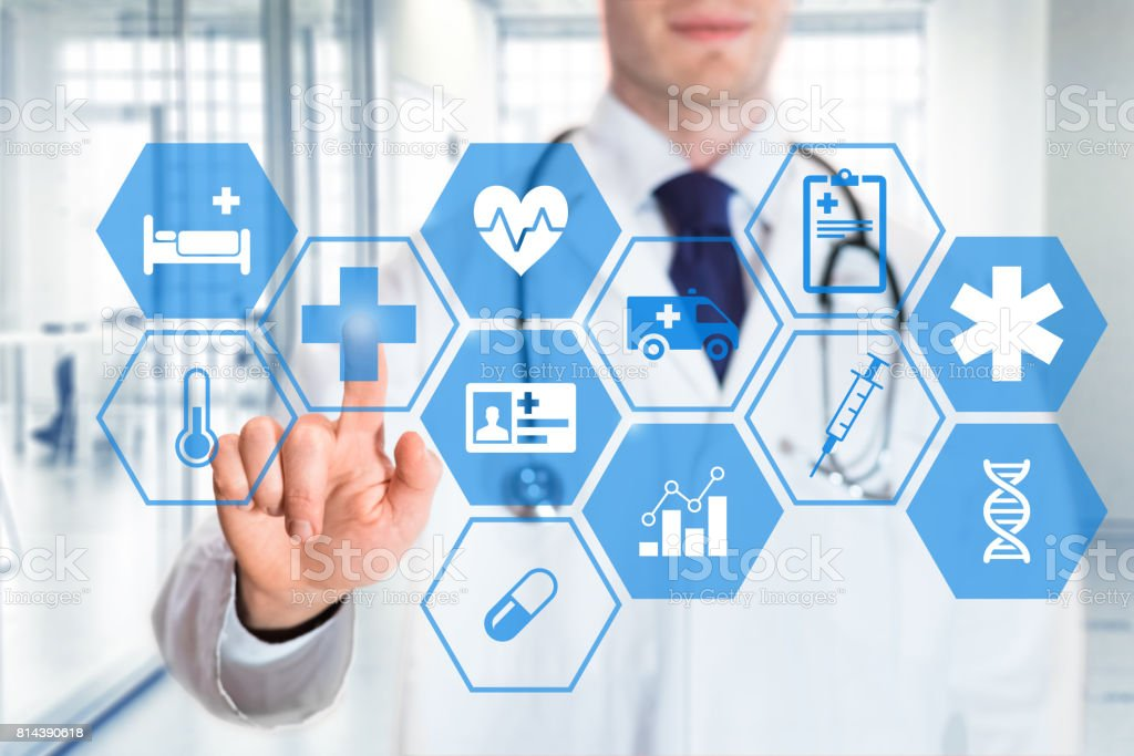 Medical doctor touching icons of healthcare services on digital screen stock photo