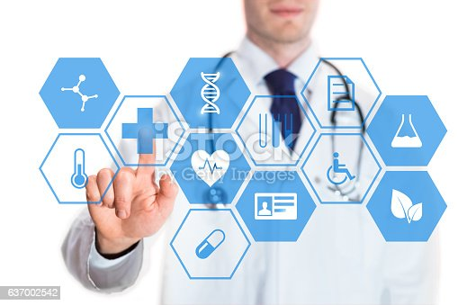 istock Medical doctor touching virtual interface button of healthcare application 637002542