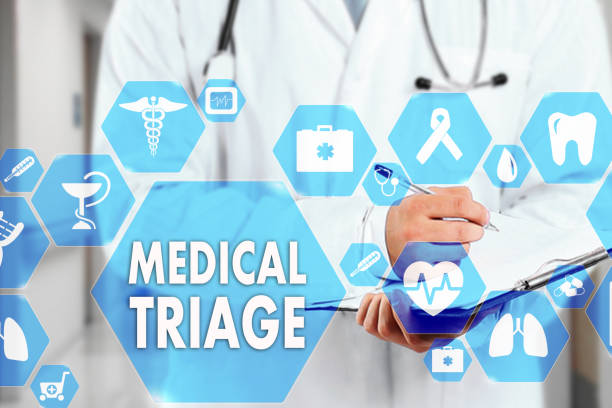 Medical Doctor with stethoscope and MEDICAL TRIAGE sign in Medical network connection on the virtual screen on hospital background.Technology and medicine concept. stock photo