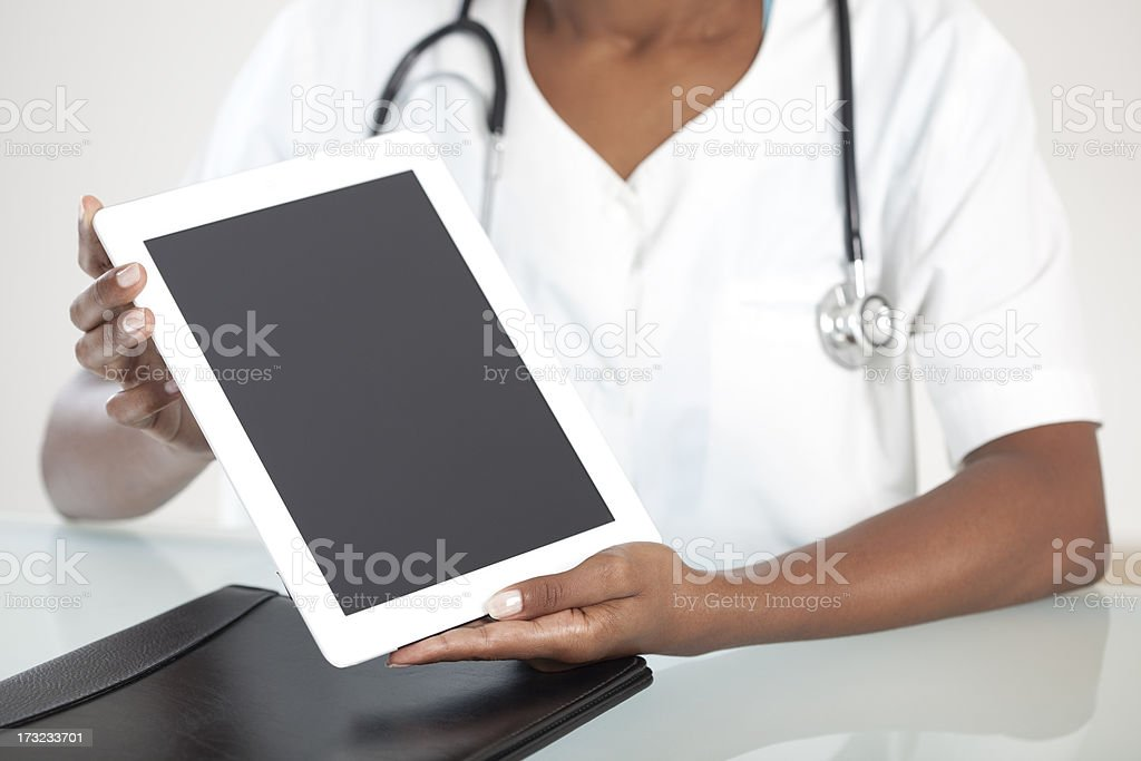 Medical doctor woman holding tablet computer. royalty-free stock photo
