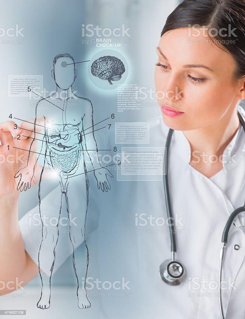 Medical doctor working virtual interface examining human body stock photo
