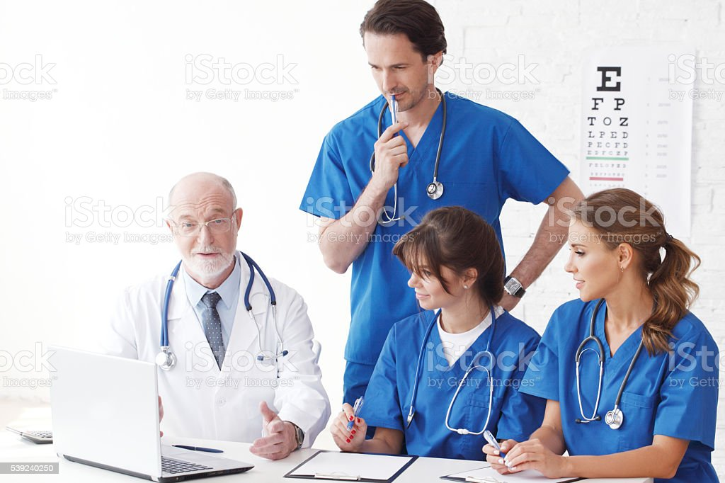 Medical doctors team using computer royalty-free stock photo