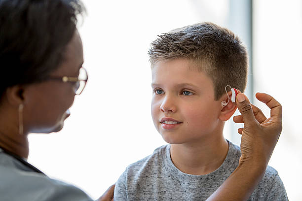 medical ear exam - hearing loss stock pictures, royalty-free photos & images