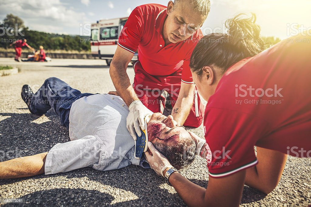Medical emergency team arrives at street accident stock photo