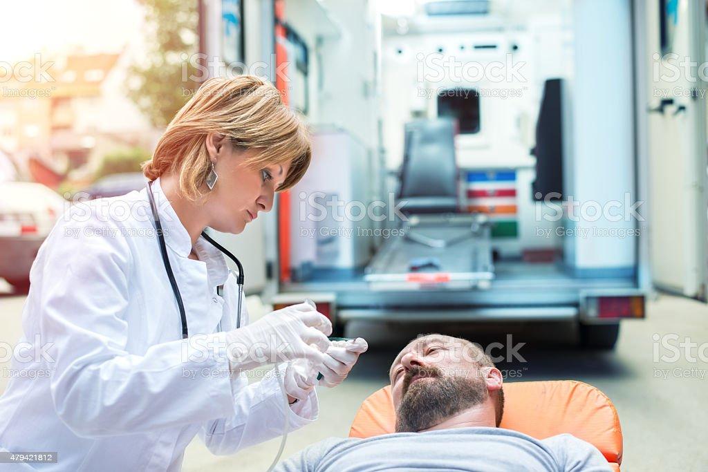 Medical emergency team helping injured man stock photo