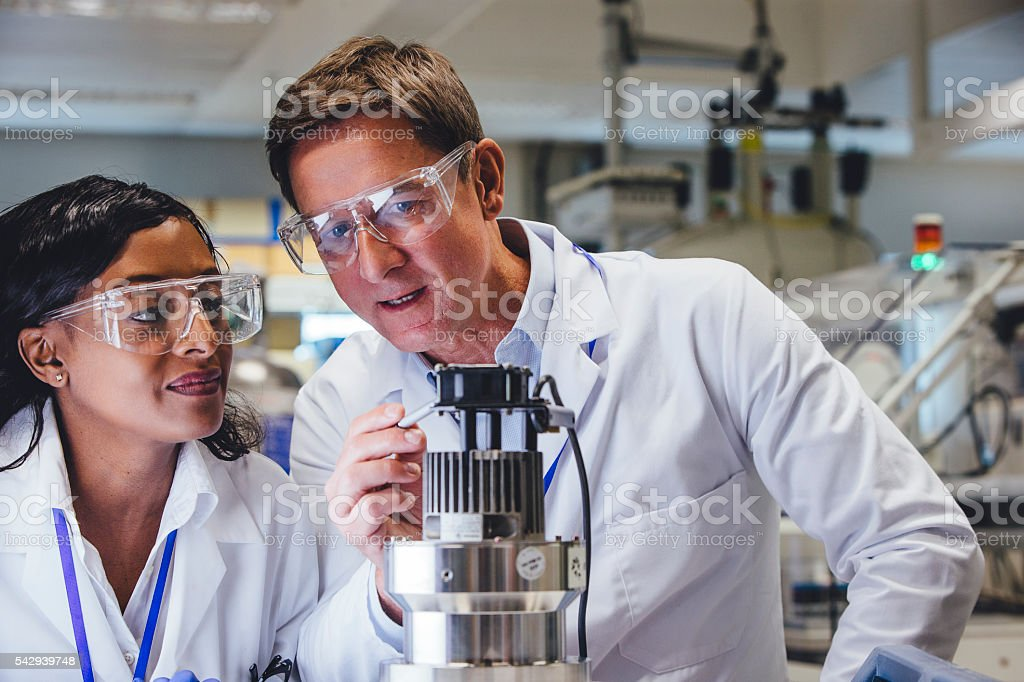 Medical Engineers Examining Equipment stock photo
