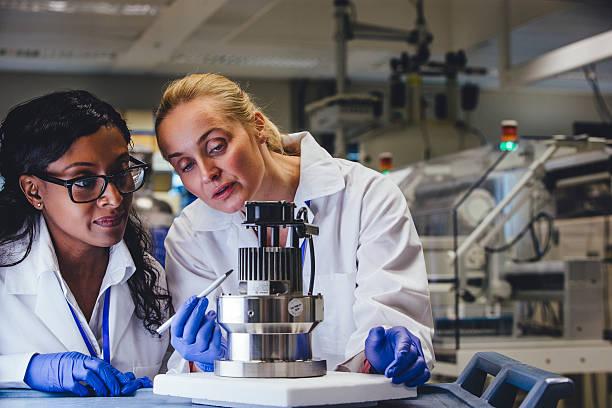 Medical Engineers Examining Equipment stock photo