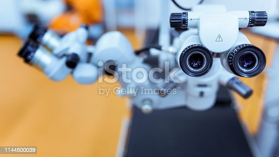 istock medical equipment. close up picture of an operating microscope in a laboratory. Ophthalmologist. health, ophthalmology concept 1144500039