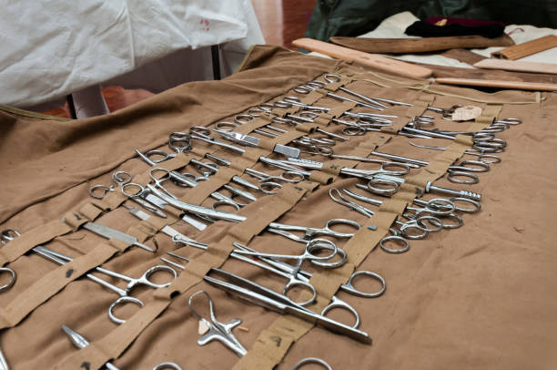 Medical equipment from World War 1 Large selection of stainless steel surgical equipment, including Magill and artery forceps, tweezers, retractors in canvas roll 1910 1919 stock pictures, royalty-free photos & images