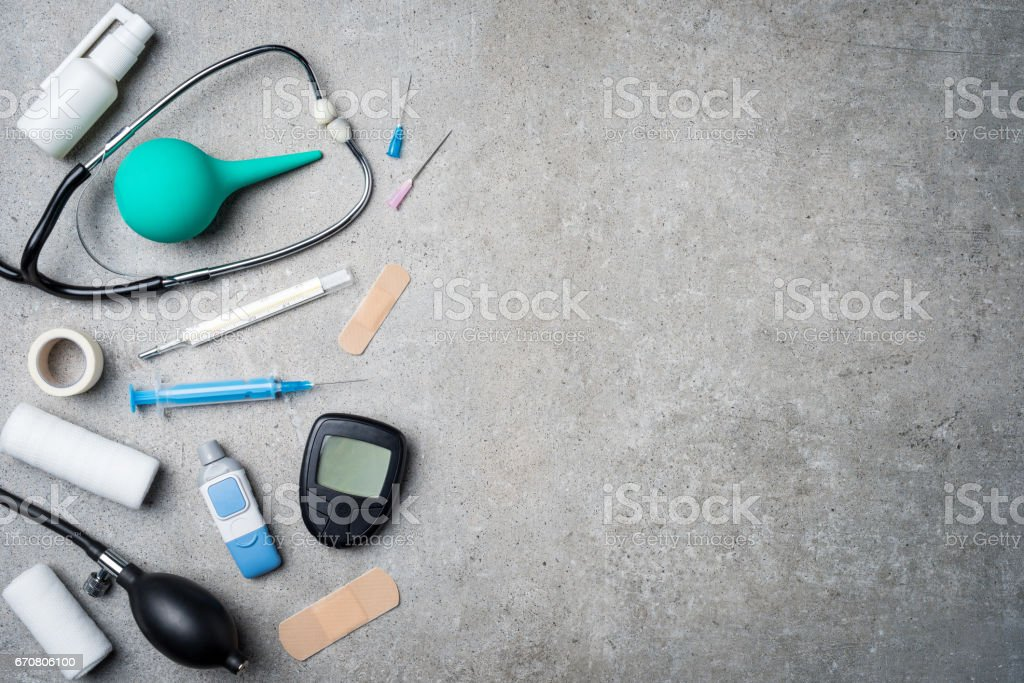 Medical equipment on gray stone background. stock photo