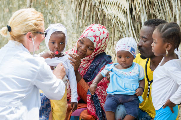 Medical exam of African little girl stock photo