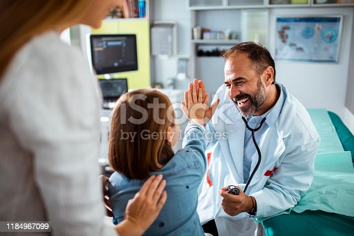 Close up of a doctor using a stethoscope to check up on his patient
