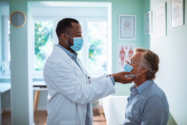 Medical Exam Close up of a mature man having a medical exam done in the doctors office patient stock pictures, royalty-free photos & images