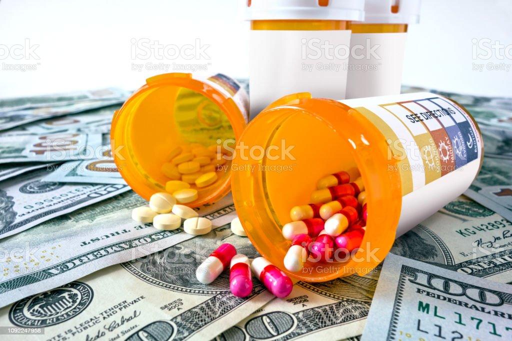 pill box and dollar bills representing medical expenses