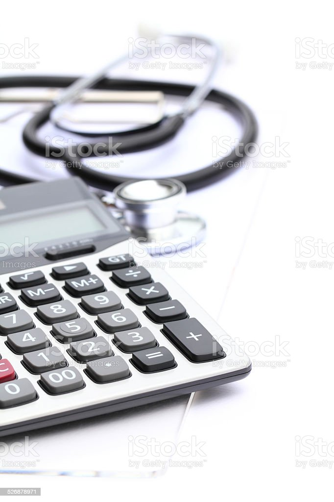Medical expenses with calculator and stethoscope
