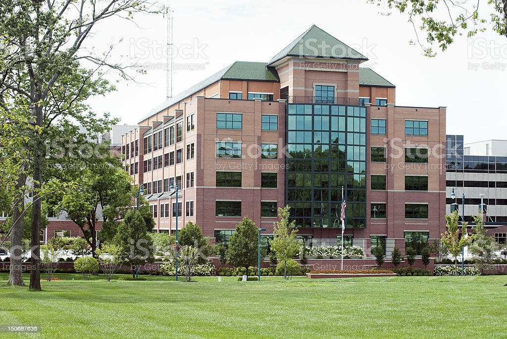 Large, modern, red brick medical facility.