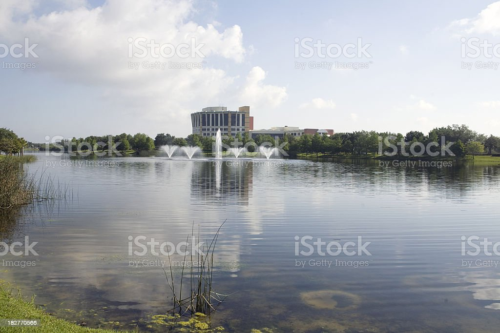A regional medical center framed with pond and fountains.