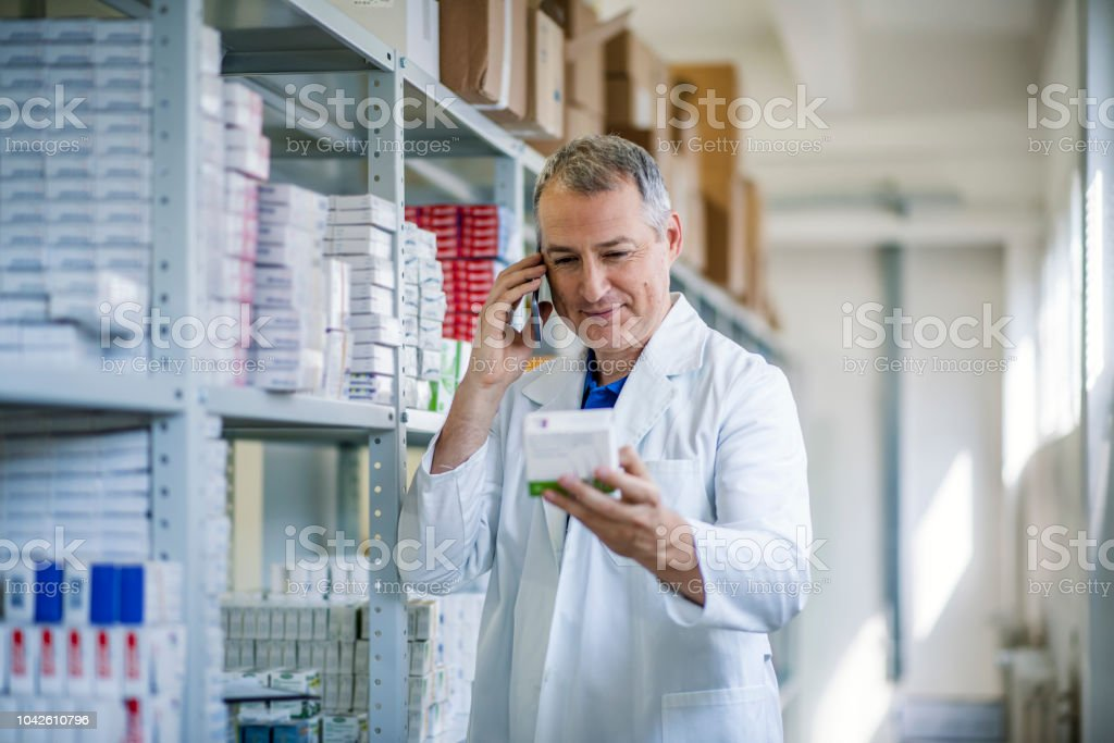 Portrait of male pharmacist chemist man in pharmacy drugstore....