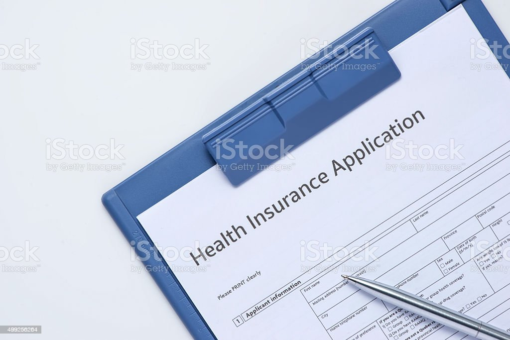 Healthcare insurance form and pen.