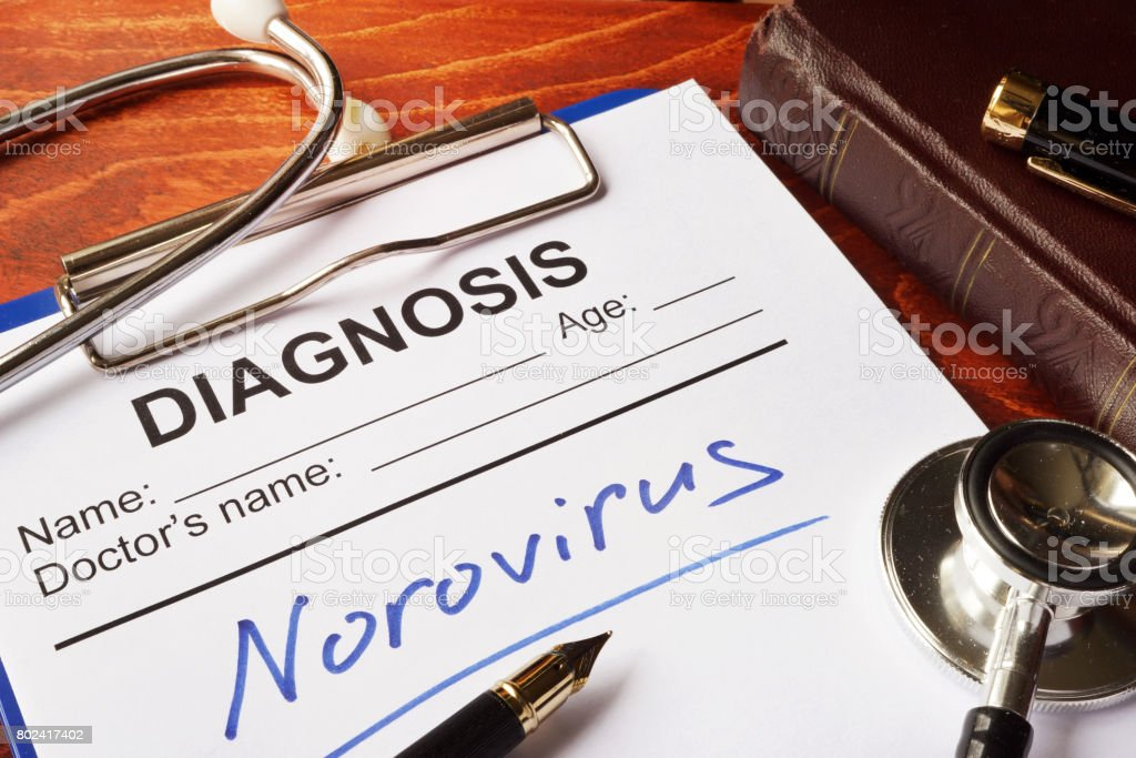 Medical form with diagnosis Norovirus on a table. stock photo