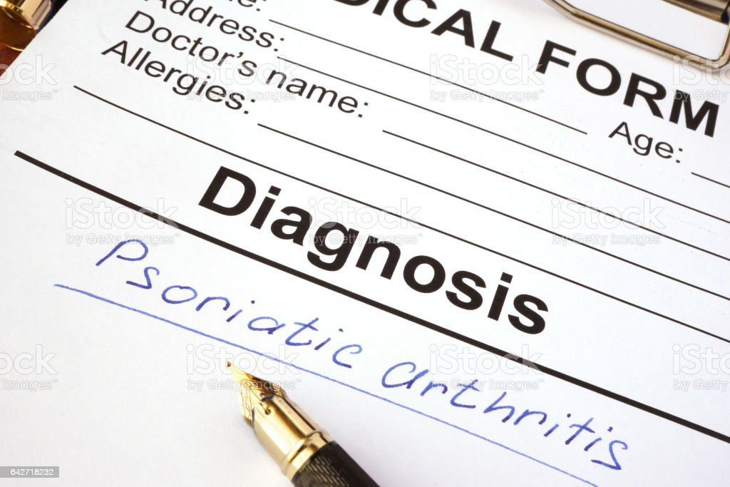Medical form with diagnosis psoriatic arthritis on a table. stock photo