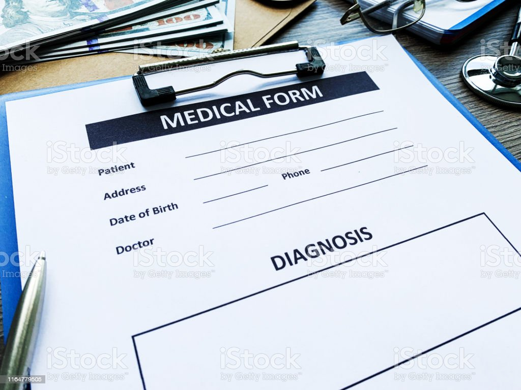 Medical form with patient data on doctor\'s desk.