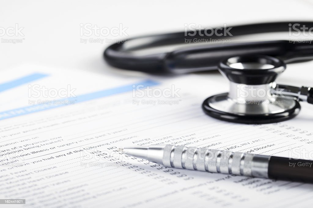 Medical form with stethoscope stock photo