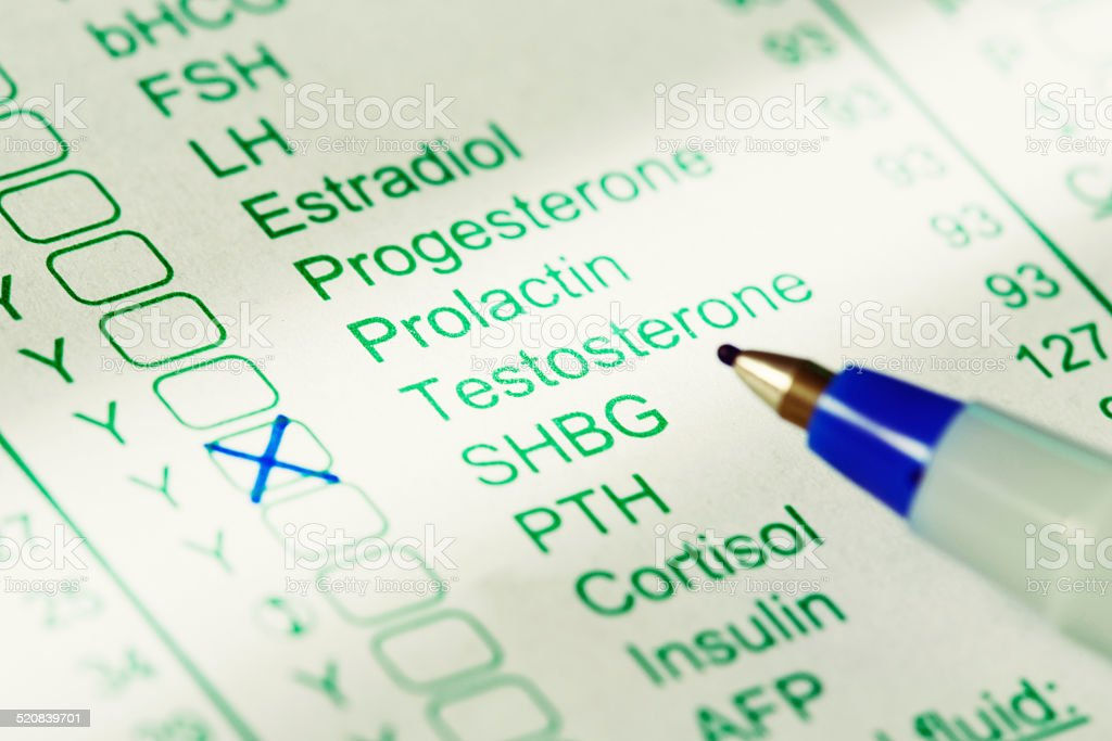A printed medical form listing blood tests has Testosterone marked. A...