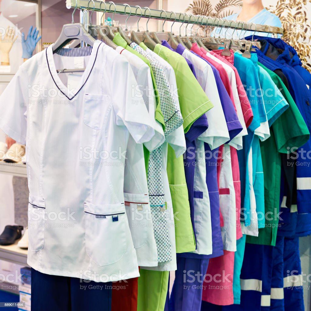Medical gowns for nurses on hanger in store stock photo