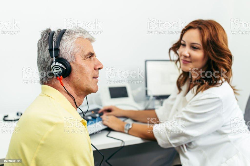 Medical hearing examination stock photo