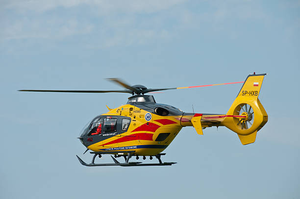 Medical helicopter Eurocopter in flight over Goraszka stock photo