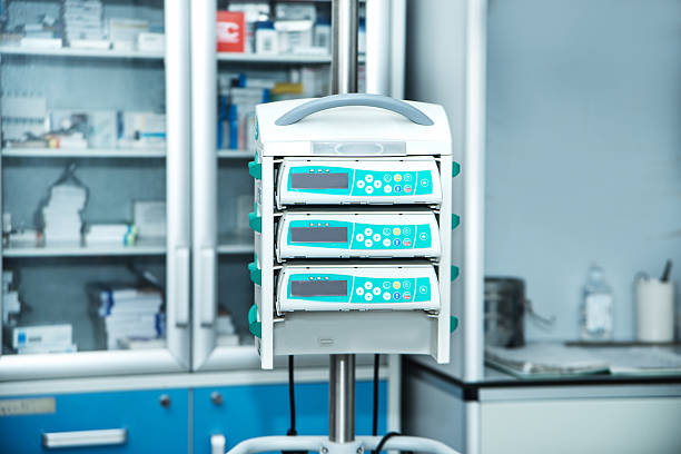 Medical Infusion Pump complex of medical equipment at work infused stock pictures, royalty-free photos & images