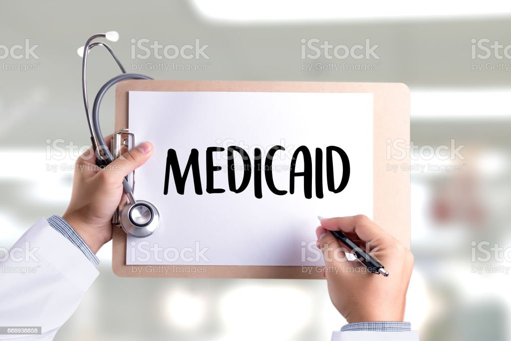 Medical insurance and Medicaid and stethoscope. stock photo