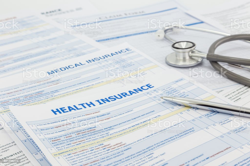Medical insurance application and legal contract stock photo