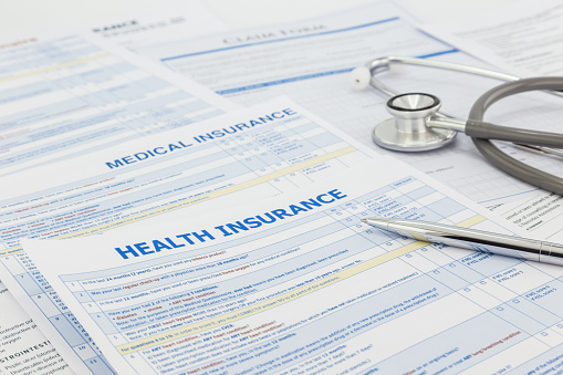 Medical Insurance Application And Legal Contract Stock Photo - Download Image Now