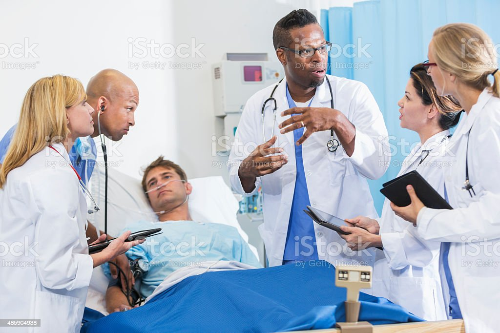 Medical interns at hospital with patient stock photo