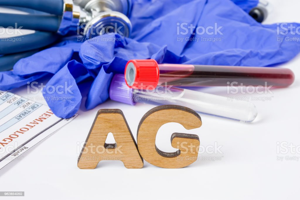 AG Medical laboratory acronym or abbreviation of antigen, immune response component, piece and immune system. Letters AG are near laboratory test tubes with blood sample, stethoscope, protection glove stock photo