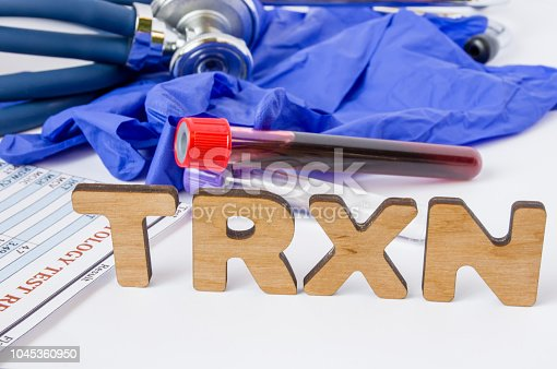 istock TRXN Medical laboratory acronym or abbreviation of transfusion reaction evaluation, blood allergic reaction. Letters TRXN are near laboratory test tubes with blood sample, stethoscope protection glove 1045360950