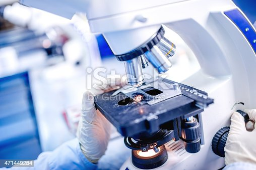Details of medical laboratory, scientist hands using microscope for chemistry test samples