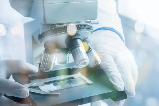 istock medical laboratory, scientist hands using microscope for chemistry ,biology test samples,examining liquid,Doctor equipment,Scientific and healthcare research background.vintage color 926522504