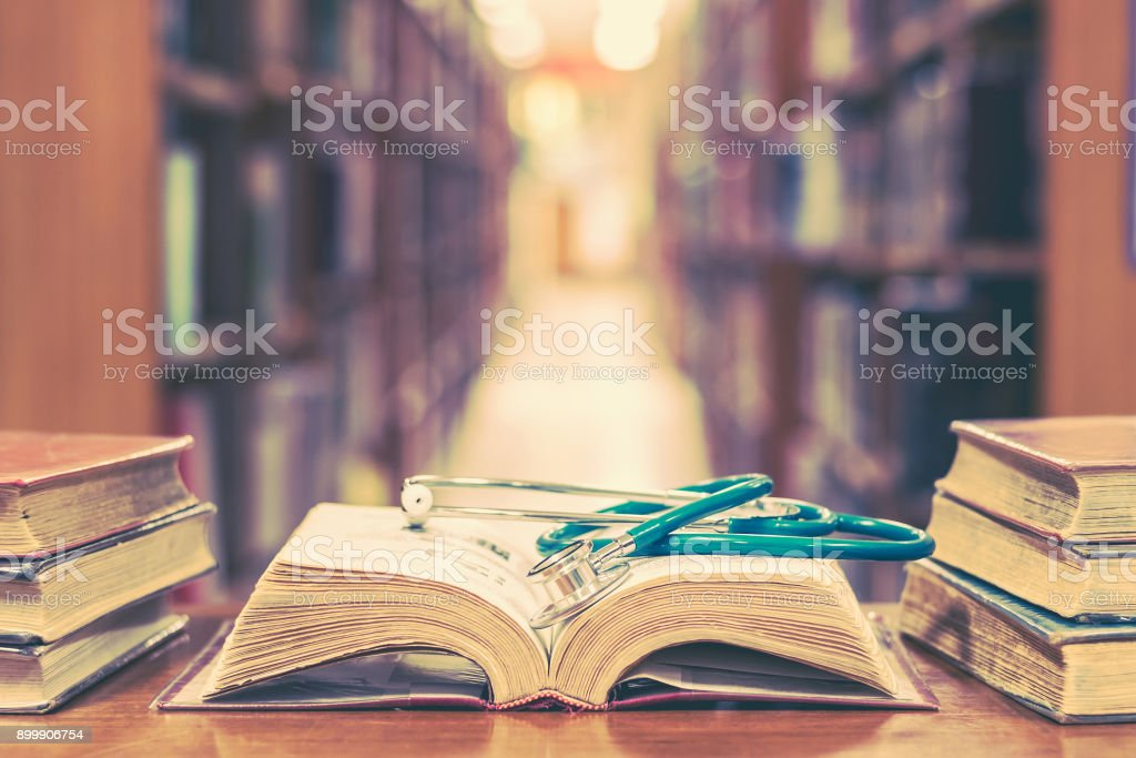 Medical library concept with stethoscope on book stock photo