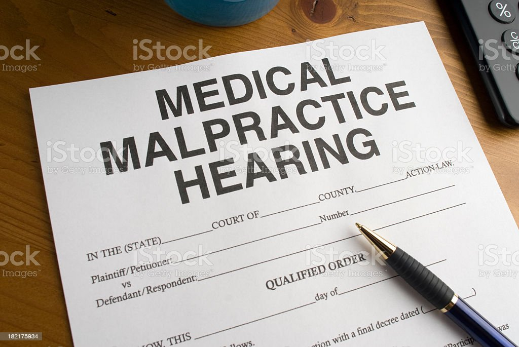 Medical malpractice hearing form and pen royalty-free stock photo