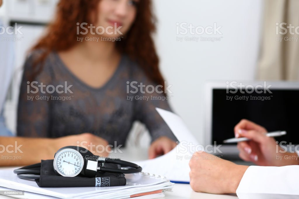Medical manometer lying on table stock photo