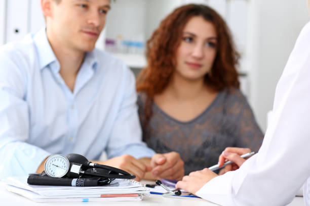 Medical manometer lying on table while doctor consult stock photo