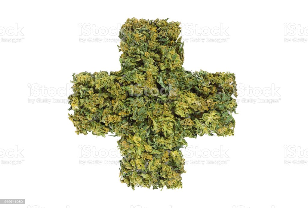 medical marijuana cross symbol stock photo