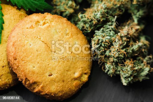 Medical Marijuana For Use In Food Cookies With Cannabis And Buds Of Marijuana On The Table Stock Photo & More Pictures of Cake