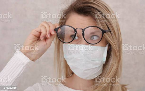 Medical mask and glasses fogging avoid face touching coronavirus picture id1216022885?b=1&k=6&m=1216022885&s=612x612&h=mg5donzytf0efokjhmcdddvweiae 1nfisnwt0oaawe=