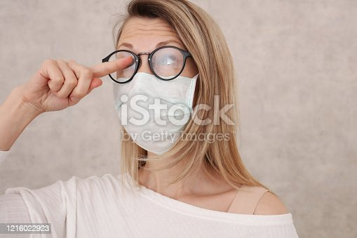 Medical mask and Glasses fogging. Avoid face touching, Coronavirus prevention, Protection.